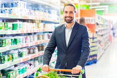 Customer with pushcart in supermarket Stock Photography