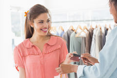 Customer receiving credit card from saleswoman Royalty Free Stock Photography