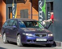 Minsk, Belarus, April 20, 2018: Customer receiving order from McDonald`s drive thru service Royalty Free Stock Photo