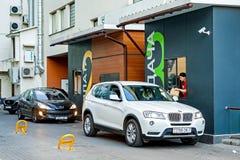 Minsk, Belarus, April 20, 2018: Customer receiving order from McDonald`s drive thru service Stock Photos
