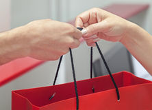 Customer receiving shopping bag from cashier Royalty Free Stock Photos
