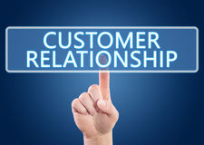 Customer Relationship. Hand pressing Customer Relationship button on interface with blue background Stock Images