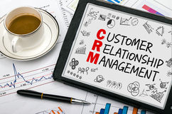 Customer relationship management concept. Handwritten on tablet pc Royalty Free Stock Photography