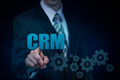 Customer relationship management concept man selecting CRM.  Royalty Free Stock Images