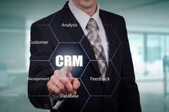 Customer relationship management concept man selecting CRM. Customer relationship management concept man selecting CRM Stock Photos