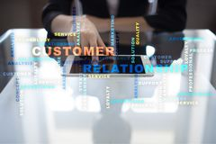 Customer relationship management concept on the virtual screen. Words cloud Stock Photo