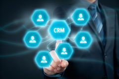Customer relationship management CRM. Customer relationship management (CRM) concept. Businessman click on virtual scheme representing CRM Stock Photos