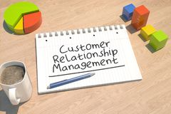 Customer Relationship Management. Text concept with notebook, coffee mug, bar graph and pie chart on wooden background - 3d render illustration Stock Photography