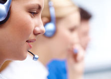 Customer Representative. Close-up of customers representative with headset in line during work Royalty Free Stock Images