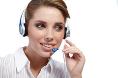 Customer Representative with headset. Smiling during a telephone conversation Royalty Free Stock Images