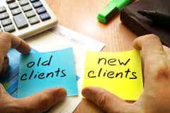 Customer retention concept. New clients vs old clients. Customer retention concept royalty free stock photos