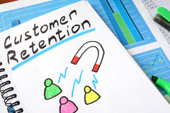Customer retention. Customer retention written in a notebook and marker royalty free stock photos