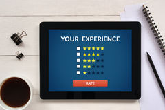 Customer review concept on tablet screen with office objects Stock Photo