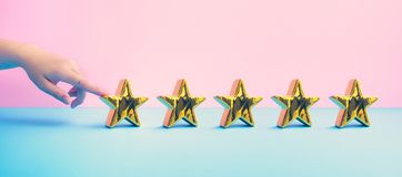 Free Customer Review Concepts With Female Finger And  Five Gold Star On Pastel Color Background Stock Photo - 160757010