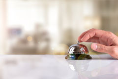 Customer ringing the bell hotel service with hotel background Stock Photo