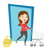 Customer running into the shop with trolley. Royalty Free Stock Photos