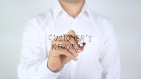 Customer's Request, Man Writing on Glass. High quality stock image