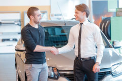 Customer and sales consultant with showroom view Stock Images