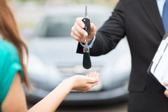 Customer and salesman with car key stock photo