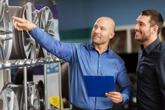 Customer and salesman at car service or auto store stock photography
