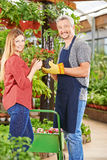 Customer and salesman in nursery shop Royalty Free Stock Photography