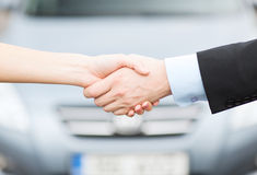 Customer and salesman shaking hands stock photo