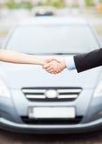 Customer and salesman shaking hands royalty free stock photo