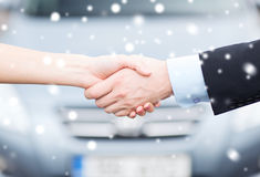 Customer and salesman shaking hands Stock Image