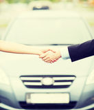 Customer and salesman shaking hands Royalty Free Stock Image