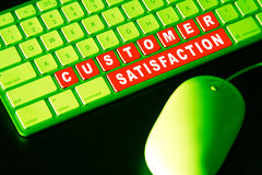 Customer Satisfaction. Special environmental effects using green. Special keys Stating customer satisfaction Stock Photo
