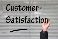 Customer satisfaction. Hand writing a heading during a presentation Royalty Free Stock Photo