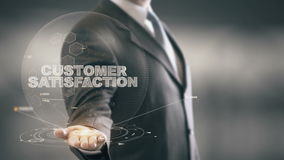 Customer Satisfaction Businessman Holding in Hand New technologies. Businessman in the future with futuristic technology Royalty Free Stock Images
