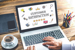 Customer Satisfaction Concept On Laptop Monitor. Customer Satisfaction Concept With Various Hand Drawn Doodle Icons On Laptop Monitor Stock Photo