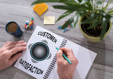 Customer satisfaction concept on a notepad Royalty Free Stock Photos