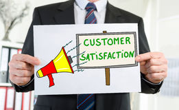 Customer satisfaction concept shown by a businessman Stock Photo