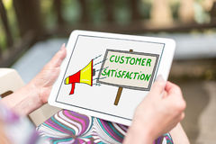 Customer satisfaction concept on a tablet. Customer satisfaction concept shown on a tablet held by a woman Royalty Free Stock Photo