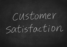 Customer satisfaction. Concept word on blackboard background Stock Photo