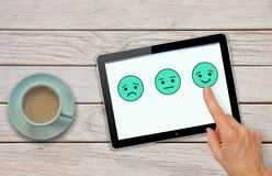 Customer satisfaction feedback survey questionnaire with hand choosing smiley royalty free stock photos
