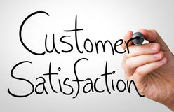 Customer Satisfaction hand writing with a black mark on a transparent board.  royalty free stock photography
