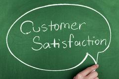 Customer Satisfaction. Note on chalkboard Stock Images