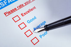 Customer satisfaction survey checkbox with rating and pen pointing at Average, can use any business concept background. Customer satisfaction survey checkbox royalty free stock photos