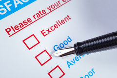 Customer satisfaction survey checkbox with rating and pen pointing at Good, can use any business concept background. Customer satisfaction survey checkbox with stock photo