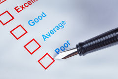 Customer satisfaction survey checkbox with rating and pen pointing at Poor, can use any business concept background. Customer satisfaction survey checkbox with royalty free stock photos