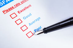 Customer satisfaction survey checkbox with rating and pen pointing at Poor, can use any business concept background. Customer satisfaction survey checkbox with stock photo