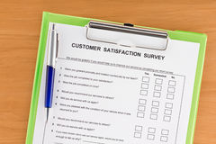 Customer Satisfaction Survey on Clipboard with Pen Royalty Free Stock Images