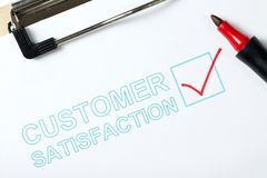 Customer satisfaction survey. Form on clipboard with red pen royalty free stock photos