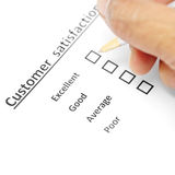 Customer satisfaction survey form with the pen checked excellent Stock Photo
