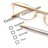 Customer satisfaction survey form with pen and eye glasses Royalty Free Stock Images