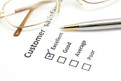 Customer satisfaction survey form with pen and eye glasses Royalty Free Stock Photos