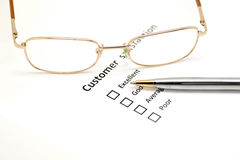 Customer satisfaction survey form with the pen and glasses Royalty Free Stock Image